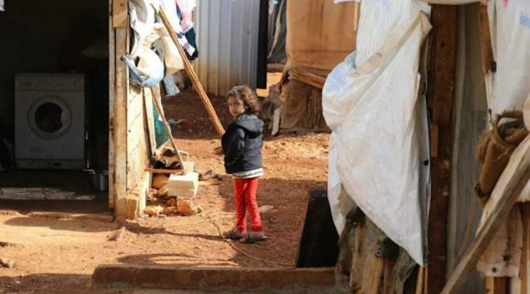 A Syrian refugee girl stands at a makeshift camp by Taybeh village, in Lebanon's eastern Bekaa Valley. (JOSEPH EID/AFP/Getty Images)